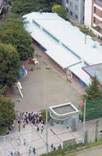 A knife-wielding woman stormed into Takachiho kindergarten, stabbing a teacher.