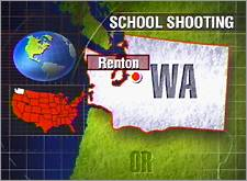 A 13-year-old student fired a gun from atop a lunch table inside the cafeteria of a Renton, Wash., middle school during summer classes Monday 7/17/2000.